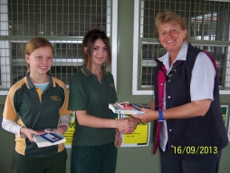 Nurse Kathy Presents Books to School